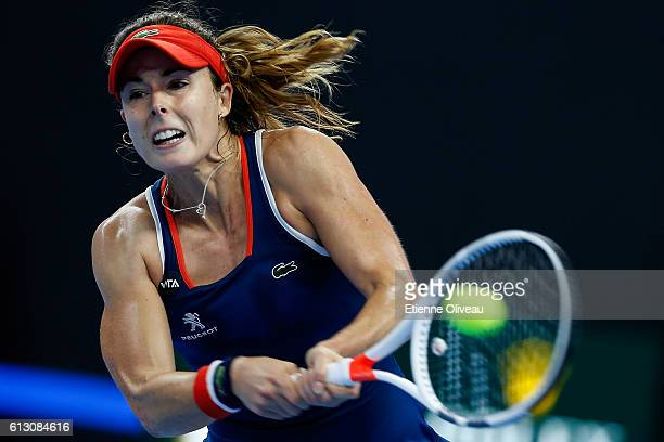 Alize Cornet of France returns a shot against Yaroslava Shvedova of Kazakhstan during the Women's singles third round match on day seven of the 2016...
