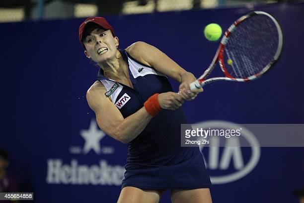 Alize Cornet of France returns a shot during her match against Hsieh Suwei of Chinese Taipei during day four of the 2014 WTA Guangzhou Open at Tianhe...