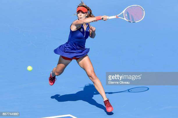 Alize Cornet of France returns a shot during her Women's singles third round match against Caroline Garcia of France on day six of the 2017 China...