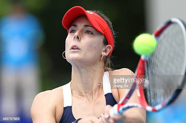 Alize Cornet of France returns a shot during the final match against Monica Niculescu of Romania on day six of the 2014 WTA Guangzhou Open at Tianhe...