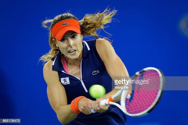 Alize Cornet of France returns a shot during the match against Maria Sakkari of Greece on Day 5 of 2017 Dongfeng Motor Wuhan Open at Optics Valley...