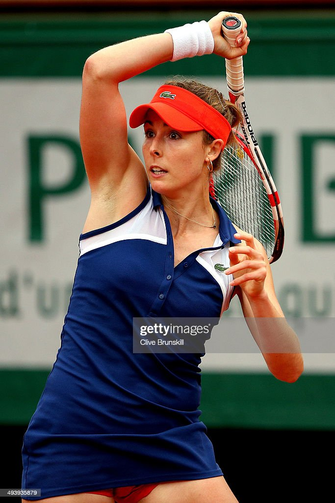 Alize Cornet of France returns a shot in her women's singles match against Ashleigh Barty of Australia on day two of the French Open at Roland Garros on May 26, 2014 in Paris, France.