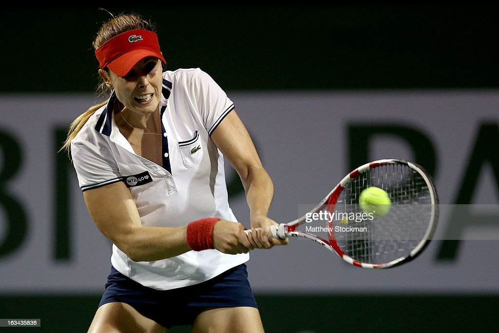 Alize Cornet of France returns a shot to Caroline Wozniacki of Denmark during the BNP Paribas Open at the Indian Wells Tennis Garden on March 9, 2013 in Indian Wells, California.