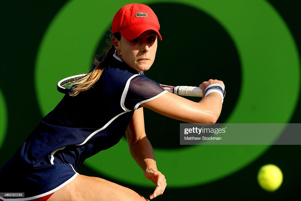 Alize Cornet of France returns a shot to Dominika Cibulkova of Slovakia during the Sony Open at the Crandon Park Tennis Center on March 23, 2014 in Key Biscayne, Florida.