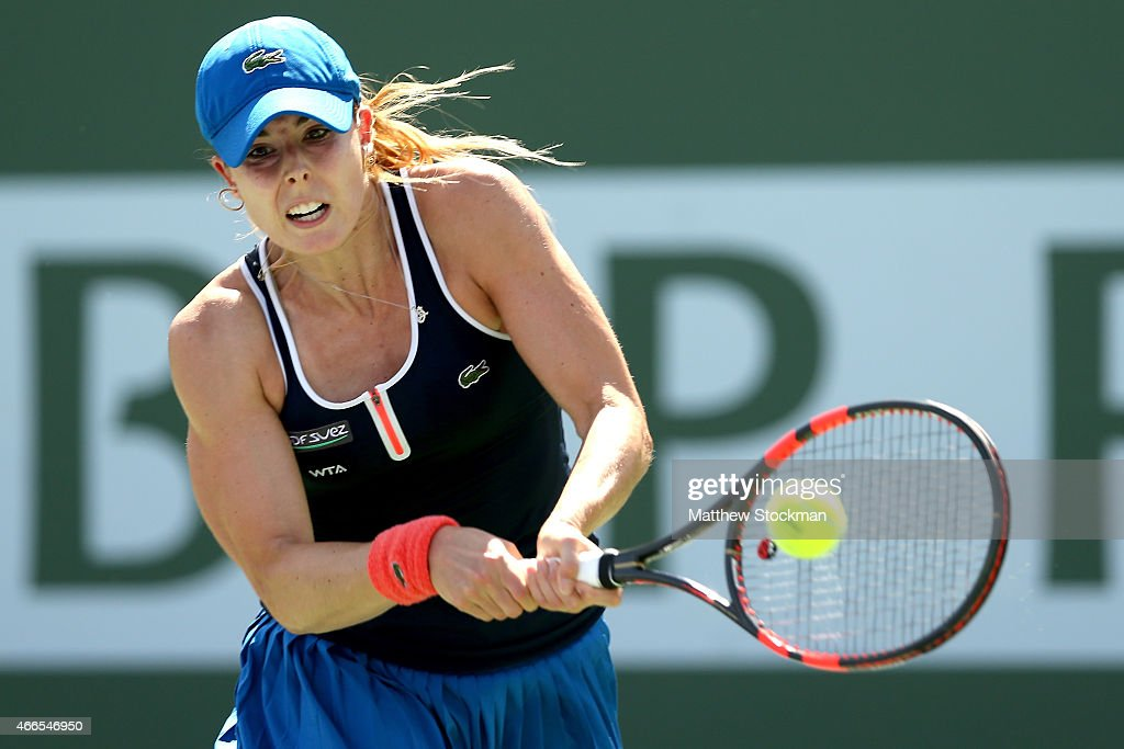 Alize Cornet of France returns a shot to Lesia Tsurenko of Ukraine during day eight of the BNP Paribas Open at the Indian Wells Tennis Garden on March 16, 2015 in Indian Wells, California.