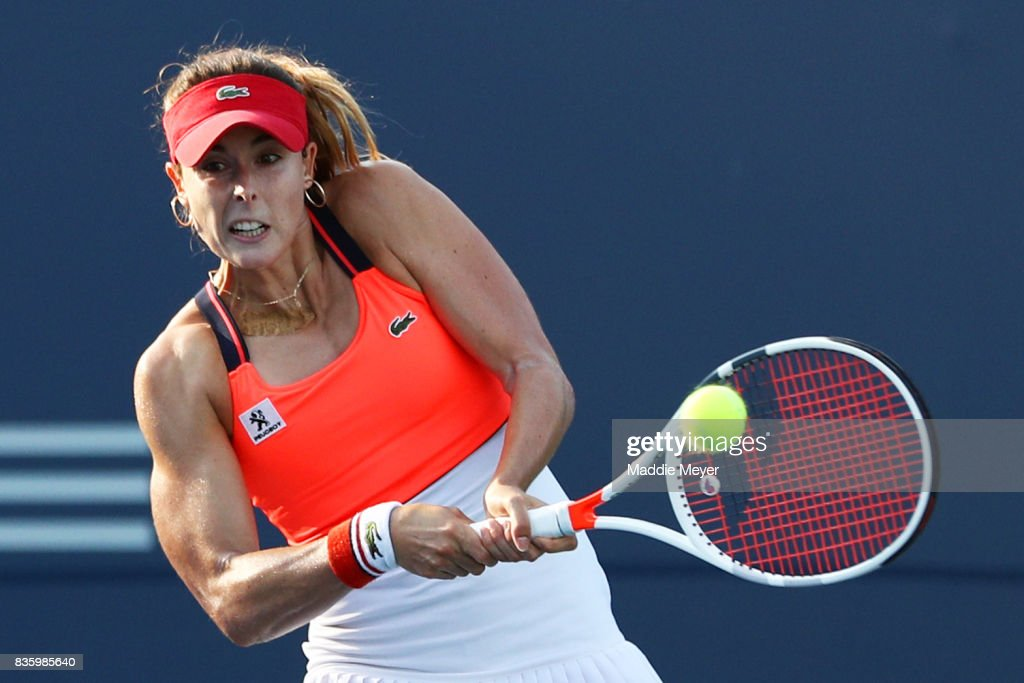 Alize Cornet of France returns a shot to Yulia Putintseva of Kazakhstan during Day 3 of the Connecticut Open at Connecticut Tennis Center at Yale on August 20, 2017 in New Haven, Connecticut.