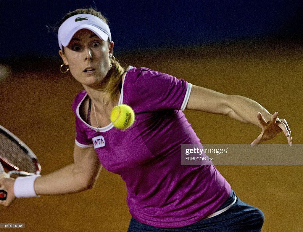 Alize Cornet of France returns the ball to Sara Errani of Italy during their semi-final Mexico WTA Open women's single tennis match, in Acapulco, Guerrero state on March 1, 2013. AFP PHOTO/ Yuri CORTEZ