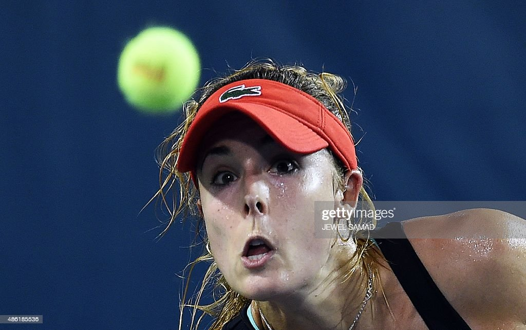 Alize Cornet of France returns to Kurumi Nara of Japan during their Women's Singles round 1 match of the US Open at USTA Billie Jean King National Tennis Center in New York on September 1, 2015.