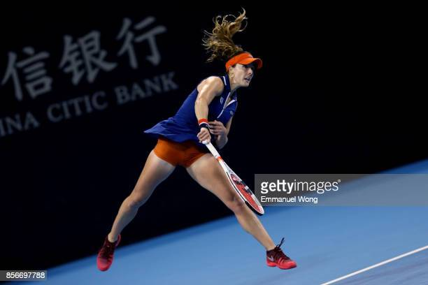 Alize Cornet of France serves against Angelique Kerber of Germany on day three of the 2017 China Open at the China National Tennis Centre on October...