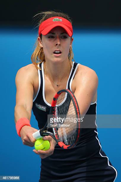 Alize Cornet of France serves in her first round match against Shuai Zhang of China during day two of the 2015 Australian Open at Melbourne Park on...