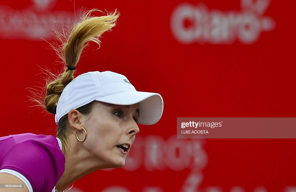 Alize Cornet of France serves the ball to Elina Svitolina of Ukraine during the WTA Bogota Open tennis Championship, on February 18, 2013. AFP PHOTO/Luis Acosta