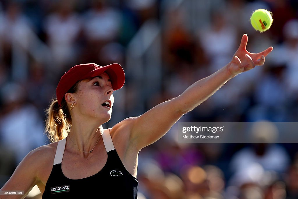 Alize Cornet of France serves to Lucie Safarova of the Czech Republic during their women's singles third round match on Day Five of the 2014 US Open at the USTA Billie Jean King National Tennis Center on August 29, 2014 in the Flushing neighborhood of the Queens borough of New York City.