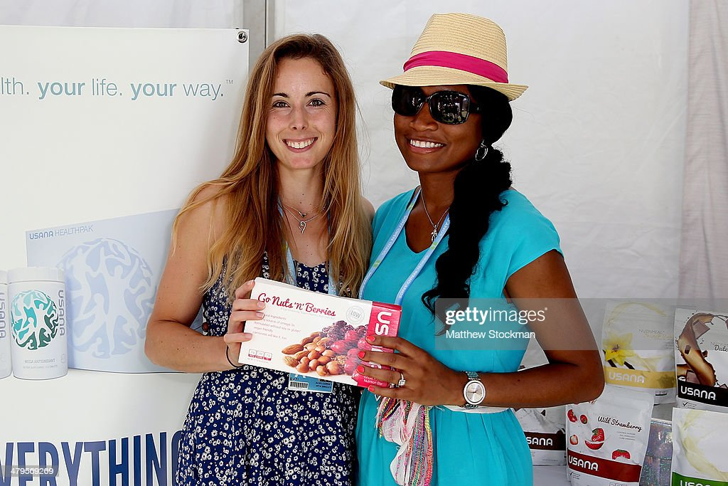 Alize Cornet of France signs autographs and poses for pictures during the Sony Open at the Crandon Park Tennis Center on March 19, 2014 in Key Biscayne, Florida.