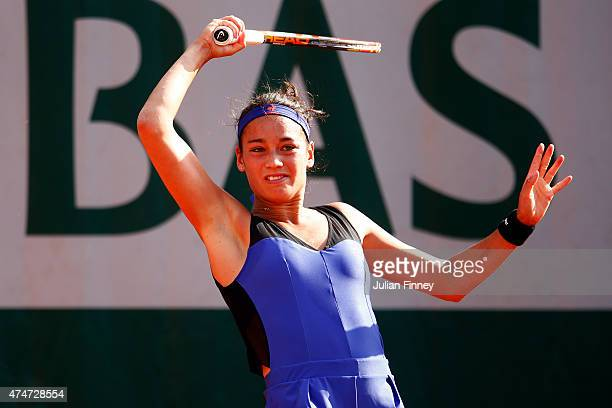 Alize Lim of France in action in her Women's Singles match against Andreea Mitu of Romania on day two of the 2015 French Open at Roland Garros on May...