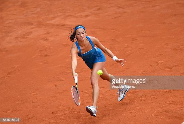 Alize Lim of France in an action during women's single first round match against Camila Giorgi of Italy at the French Open tennis tournament at...