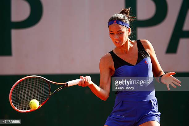 Alize Lim of France plays a forehand in her Women's Singles match against Andreea Mitu of Romania on day two of the 2015 French Open at Roland Garros...