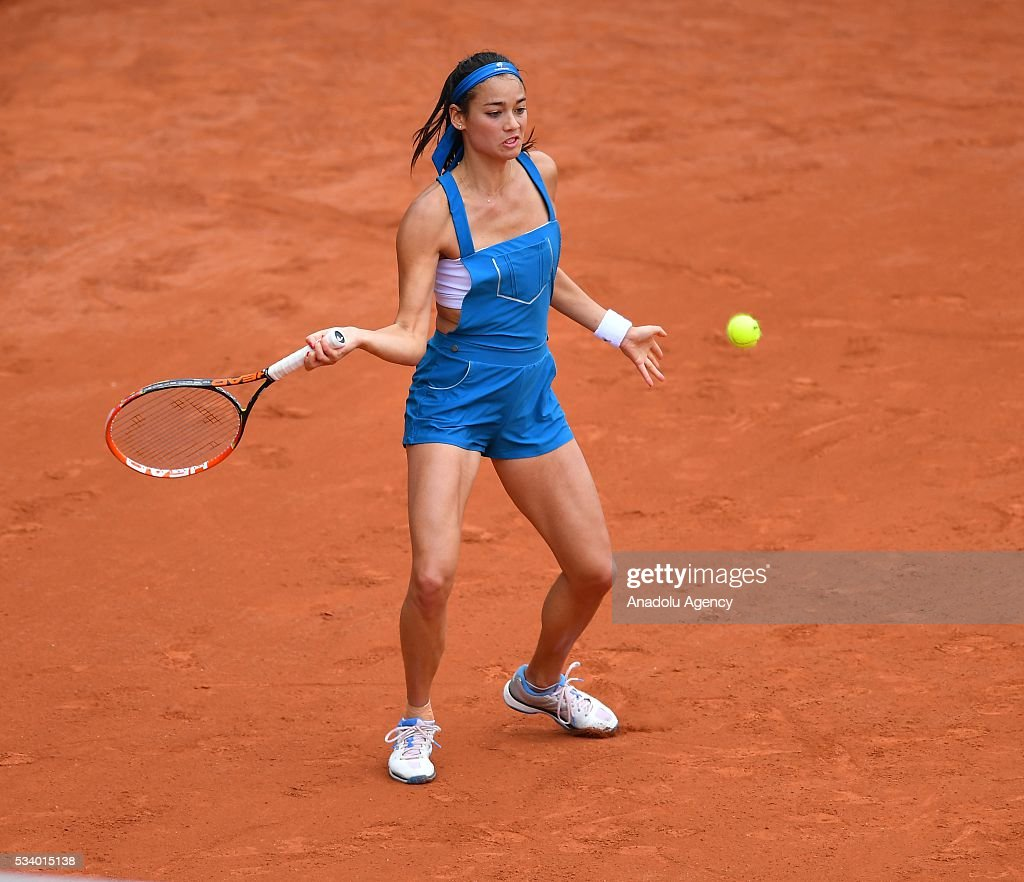 Alize Lim of France returns the ball during women's single first round match against Camila Giorgi of Italy at the French Open tennis tournament at Roland Garros in Paris, France on May 24, 2016.