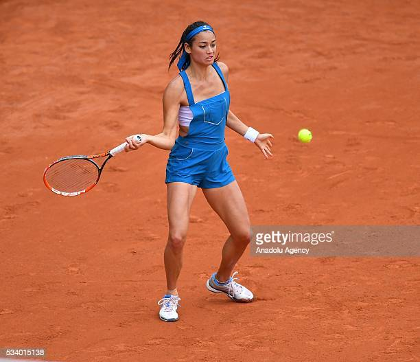Alize Lim of France returns the ball during women's single first round match against Camila Giorgi of Italy at the French Open tennis tournament at...