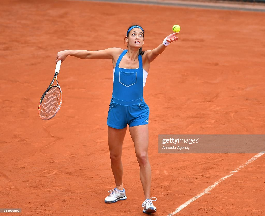 Alize Lim of France serves the ball during women's single first round match against Camila Giorgi of Italy at the French Open tennis tournament at Roland Garros in Paris, France on May 24, 2016.