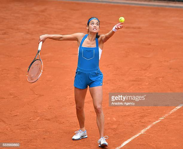 Alize Lim of France serves the ball during women's single first round match against Camila Giorgi of Italy at the French Open tennis tournament at...