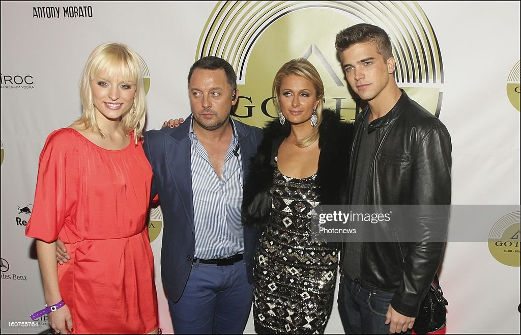 Alizee Poulicek, Daniel Camus owners of the Gotha Club with Paris Hilton and her boyfriend Riper Viperi during the party she hosted at the Gotha Club on January 31, 2013 in Brussels , Belgium.