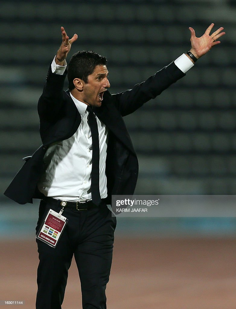 Al-Jaish's Romanian coach Razvan Lucescu gestures to his players during the Qatar Stars League football match in Doha on March 3, 2013. Al-Jaish won 1-0. AFP PHOTO/AL-WATAN DOHA/KARIM JAAFAR == QATAR OUT ==