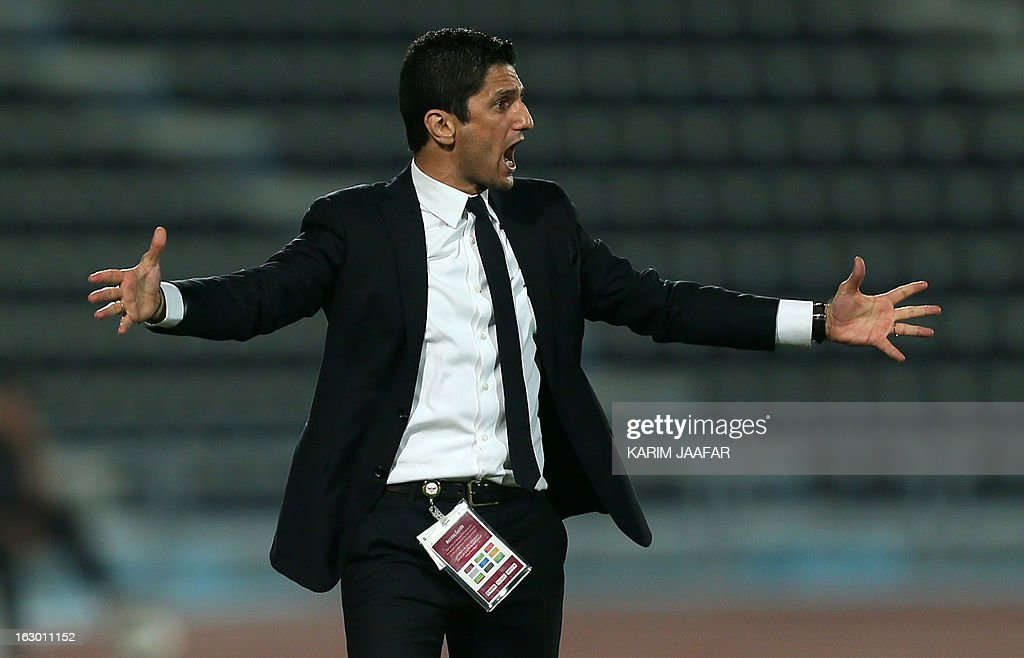 Al-Jaish's Romanian coach Razvan Lucescu gestures to his players during the Qatar Stars League football match in Doha on March 3, 2013. Al-Jaish won 1-0.