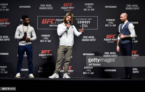 Aljamain Sterling Mike Perry and UFC commentator Dan Hardy interact with fans during a QA session before the UFC Fight Night Weighin inside Ergo...