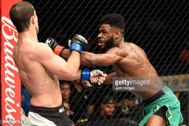 Aljamain Sterling punches Augusto Mendes of Brazil in their bantamweight fight during the UFC Fight Night event at Sprint Center on April 15 2017 in...