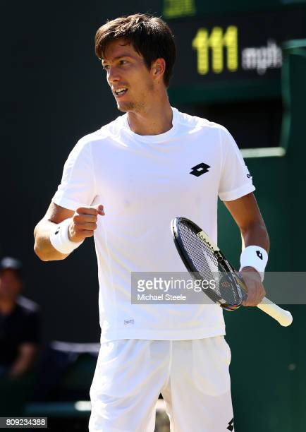 Aljaz Bedene of Great Britain acknowledges the crowd as he celebrates victory after the Gentlemen's Singles second round match against Damir Dzumhur...