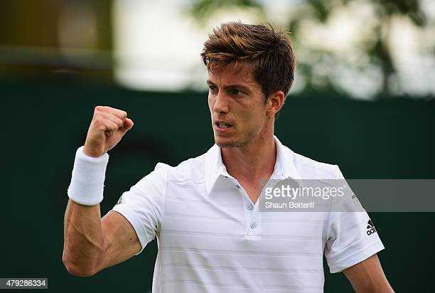 Aljaz Bedene of Great Britain celebrates during his Gentlemens Singles Second Round match against Viktor Troicki of Serbia during day four of the...