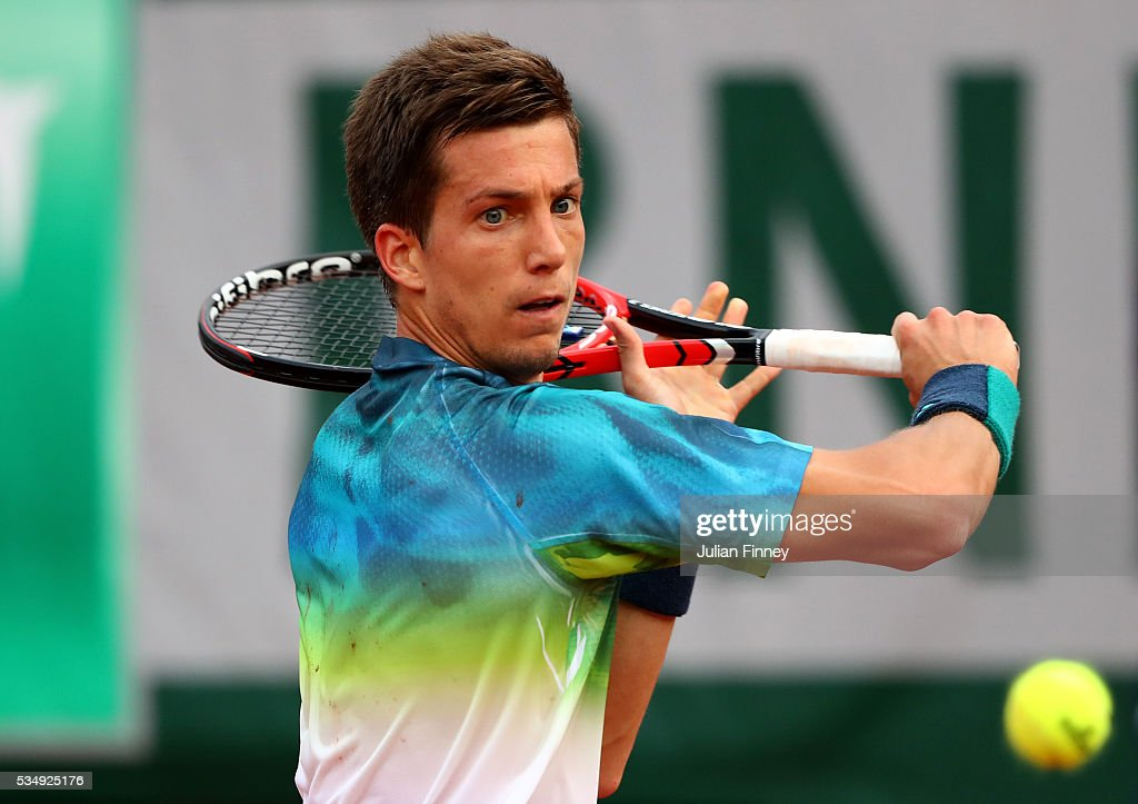 Aljaz Bedene of Great Britain hits a backhand during the Men's Singles third round match against Novak Djokovic of Serbia on day seven of the 2016 French Open at Roland Garros on May 28, 2016 in Paris, France.