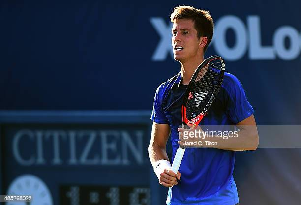 Aljaz Bedene of Great Britain looks on after a point against Gilles Simon of France during the second day of the WinstonSalem Open at Wake Forest...