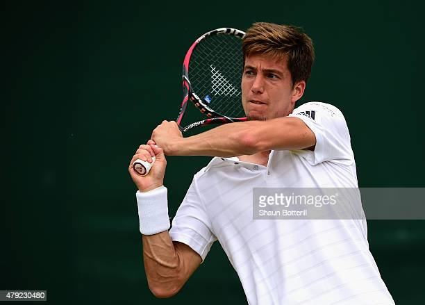 Aljaz Bedene of Great Britain plays a backhand during his Gentlemens Singles Second Round match against Viktor Troicki of Serbia during day four of...