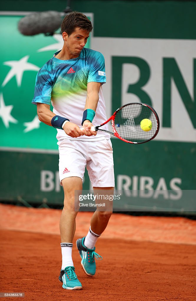 Aljaz Bedene of Great Britain plays a backhand during the Men's Singles second round match against Pablo Careeno Busta of Spain on day five of the 2016 French Open at Roland Garros on May 26, 2016 in Paris, France.