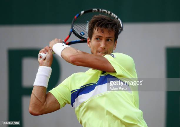 Aljaz Bedene of Great Britain plays a backhand during the mens singles second round match against Jiri Vesely of The Czech Republic on day four of...