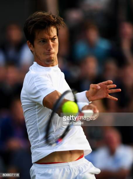 Aljaz Bedene of Great Britain plays a forehand during the Gentlemen's Singles first round match against Ivo Karlovic of Croatia on day one of the...