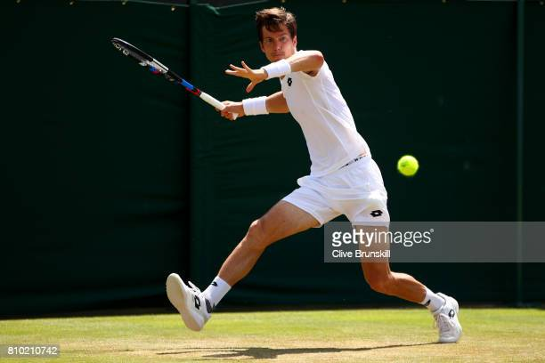 Aljaz Bedene of Great Britain plays a forehand during the Gentlemen's Singles third round match against Gilles Muller of Luxembourg on day five of...