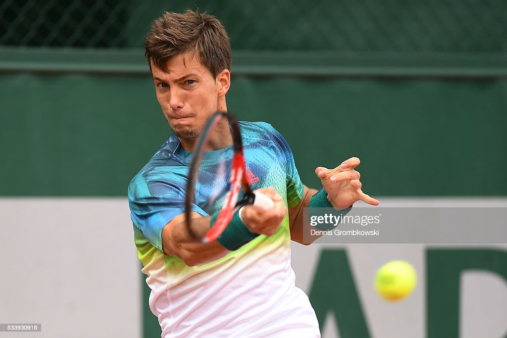 Aljaz Bedene of Great Britain plays a forehand during the Men's Singles first round match against Gerald Melzer of Australia on day three of the 2016 French Open at Roland Garros on May 24, 2016 in Paris, France.