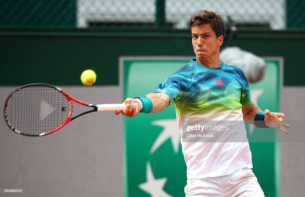 Aljaz Bedene of Great Britain plays a forehand during the Men's Singles second round match against Pablo Careeno Busta of Spain on day five of the 2016 French Open at Roland Garros on May 26, 2016 in Paris, France.