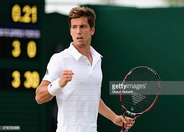 Aljaz Bedene of Great Britain reacts during his Gentlemens Singles Second Round match against Viktor Troicki of Serbia during day four of the...
