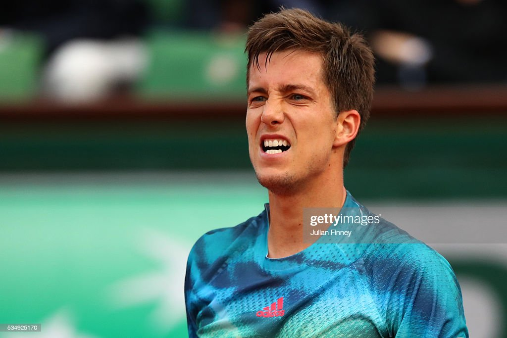 Aljaz Bedene of Great Britain reacts during the Men's Singles third round match against Novak Djokovic of Serbia on day seven of the 2016 French Open at Roland Garros on May 28, 2016 in Paris, France.