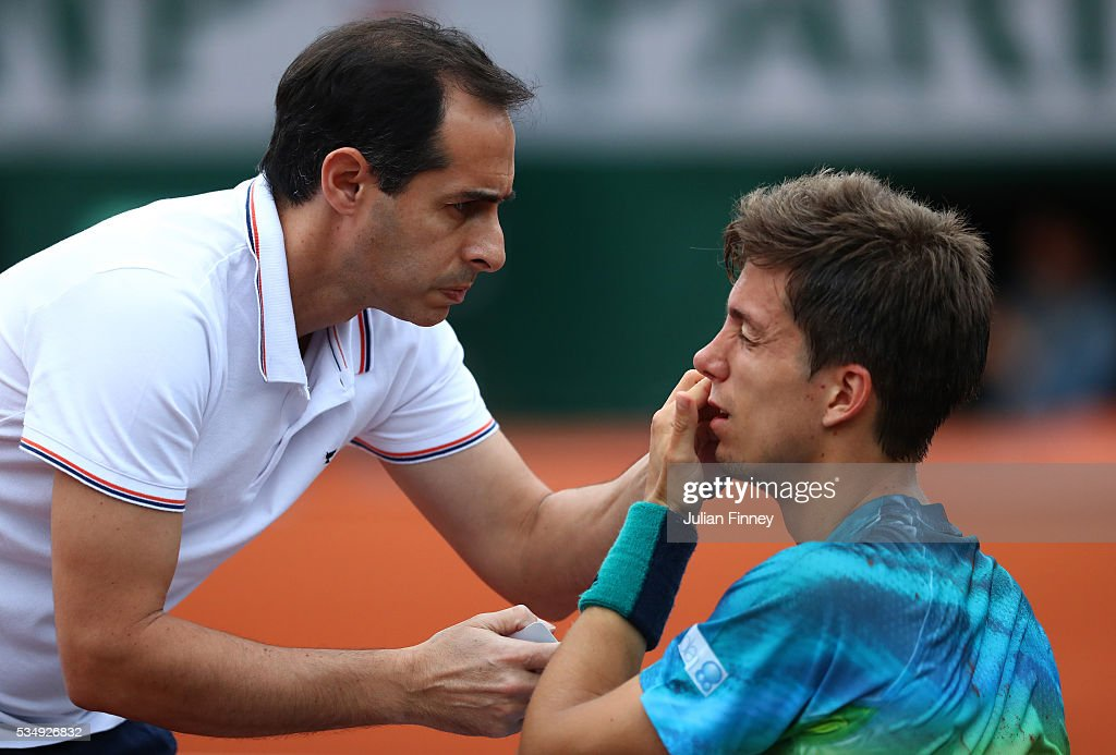 Aljaz Bedene of Great Britain receives treatment during the Men's Singles third round match against Novak Djokovic of Serbia on day seven of the 2016 French Open at Roland Garros on May 28, 2016 in Paris, France.
