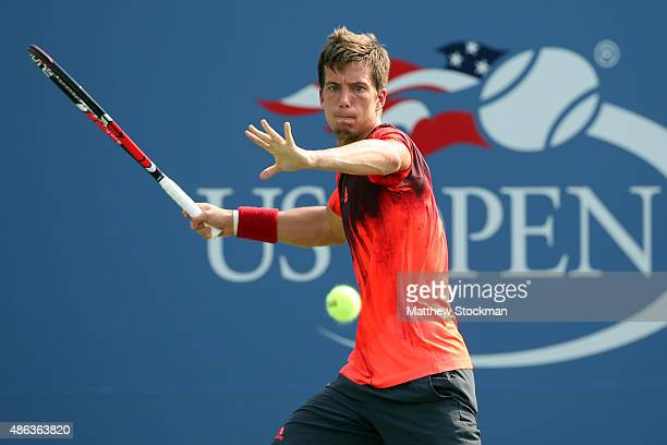 Aljaz Bedene of Great Britain returns a shot against Donald Young of the United States during their Men's Singles Second Round match on Day Four of...