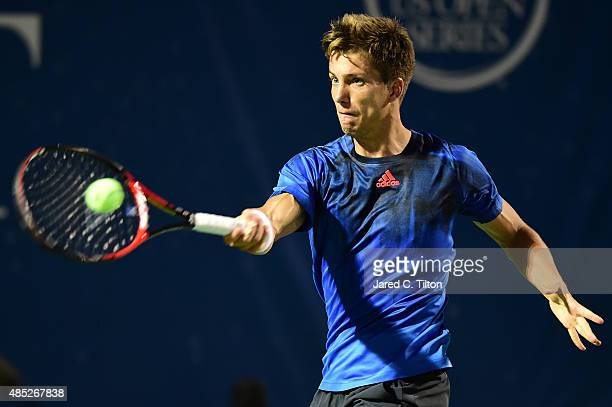Aljaz Bedene of Great Britain returns a shot from Gilles Simon of France during the second day of the WinstonSalem Open at Wake Forest University on...