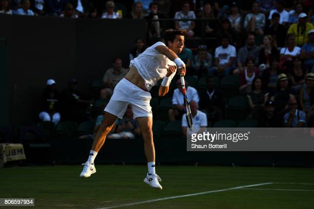 Aljaz Bedene of Great Britain serves during the Gentlemen's Singles first round match against Ivo Karlovic of Croatia on day one of the Wimbledon...