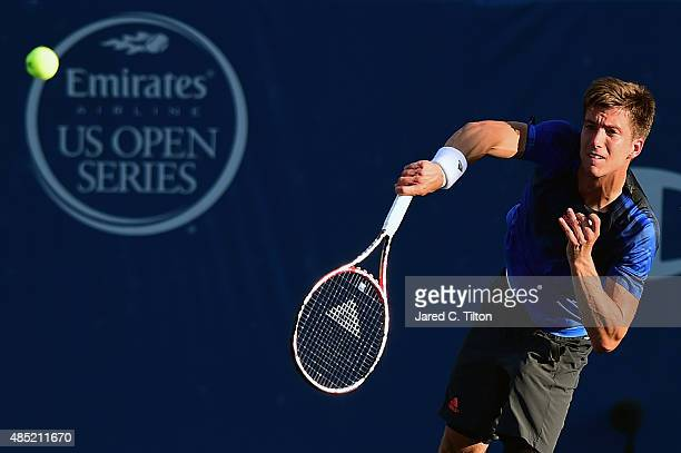 Aljaz Bedene of Great Britain serves to Gilles Simon of France during the second day of the WinstonSalem Open at Wake Forest University on August 25...