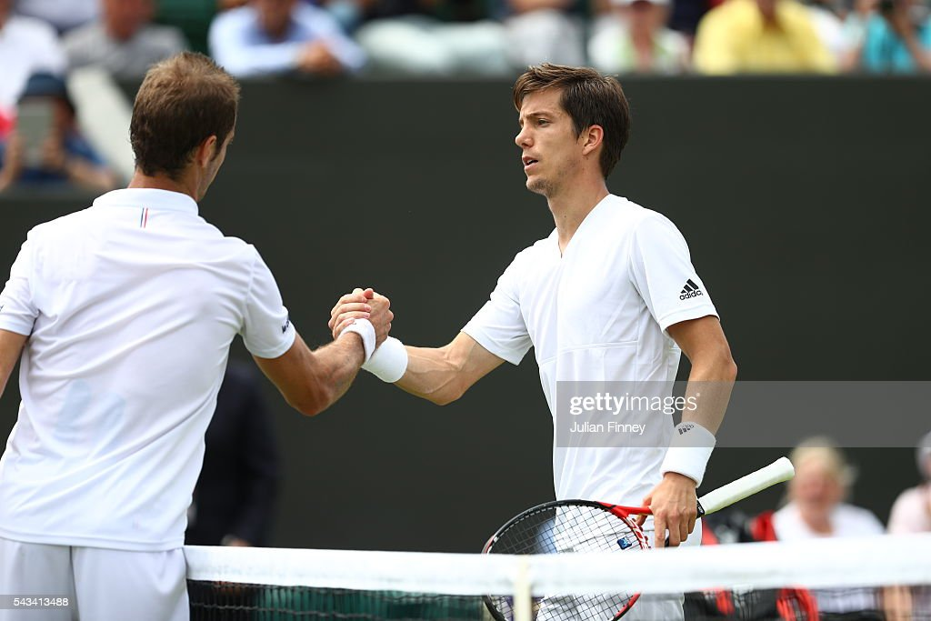 Aljaz Bedene of Great Britain shakes hands with Richard Gasquet of France follwing the Men's Singles first round match on day two of the Wimbledon Lawn Tennis Championships at the All England Lawn Tennis and Croquet Club on June 28, 2016 in London, England.