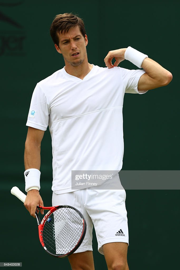 Aljaz Bedene of Great BritAnnika Beck of Great Britain looks on during the Men's Singles first round match against Richard Gasquet of France on day two of the Wimbledon Lawn Tennis Championships at the All England Lawn Tennis and Croquet Club on June 28, 2016 in London, England.