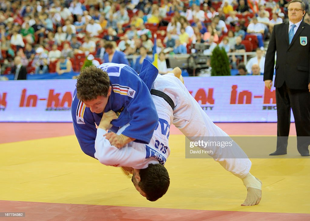 <a gi-track='captionPersonalityLinkClicked' href=/galleries/search?phrase=Aljaz+Sedej&family=editorial&specificpeople=4920040 ng-click='$event.stopPropagation()'>Aljaz Sedej</a> of the Slovenian team (white) throws Sven Maresch of Germany for a small score at the Budapest European Team Championships held at the Papp Laszlo Sports Hall, on April 28, 2013 Budapest, Hungary.
